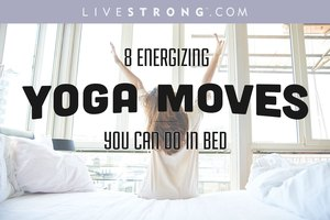 ​8 Energizing Yoga Moves You Can Do in Bed