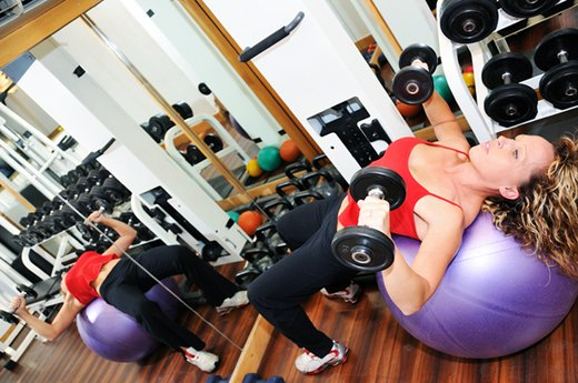 6. Lifting Heavy Weights While Lying on a Fitness Ball