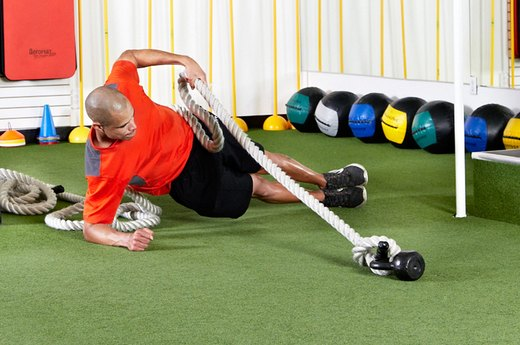 12. Side Plank With Rope Pull