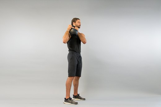 6. Kettlebell Shoulder-to-Shoulder Overhead Press
