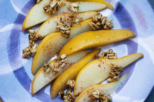 3. Poached Pears With Candied Sunflower Seeds and Cinnamon