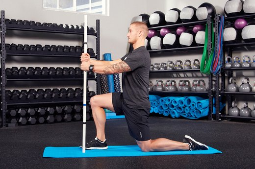 6. Half-Kneeling Quad Stretch With Stick