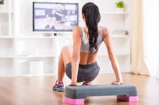6. Pop in a workout DVD.